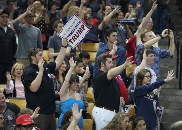 513917024-people-raise-their-arms-as-republican-presidential