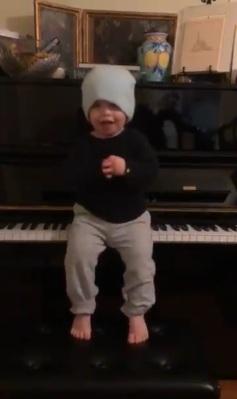 young Pecknold at the piano