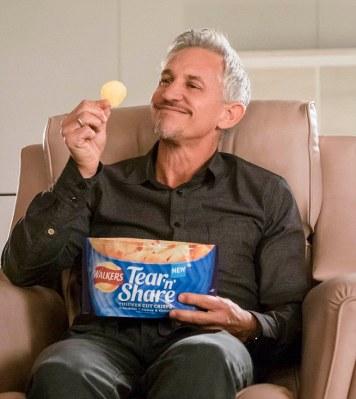 Repulsive man eating crisps